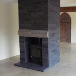 Black Brazilian slate hearth and strips on chimeny breast