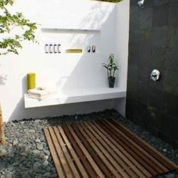 Black Brazilian slate slabs on outdoor shower wall