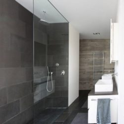 Good use of Black Brazilian slate floor and wall tiles on wetroom